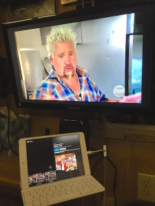 The iPad on the nightstand - streaming live TV (via Sling) to big screen over the bed.