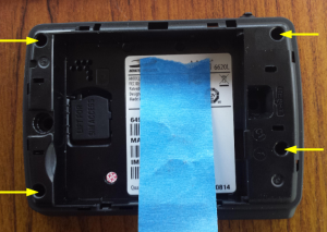 Figure 1: Back of case with battery and battery cover removed. Yellow arrows indicate case screw locations. Blue tape is just to cover my MEID.