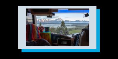 Photo taken through Class A RV dash window with a MIMO antenna mounted showing the Teton Mountains